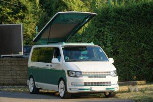 vw-t6-stylecamper-camper-bus4fun-schraeg-vorne-b4f-aufstelldach-MeerSicht